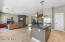 gorgeous Kahrs wood flooring, high ceiling, floor to ceiling gas fireplace