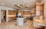 stunning kitchen with adjacent large open pantry