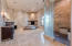 Giant walk in double shower w/ heat lamps and gas fireplace