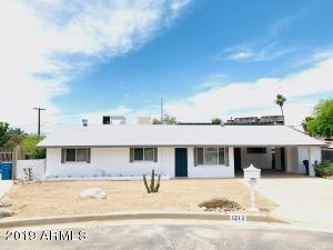 Beautiful remodel in North Central Phoenix! Gorgeous kitchen includes: stainless steel appliances and quartz countertops. Remodeled bathrooms, modern flooring, open floor plan, lots of natural light, new windows and more! Stunning mountain views with hiking trails just a few blocks away! Enjoy the quiet cul-de-sac and very large yard. It has a 2 car carport and has easy access to the 51 and downtown Phoenix. Generous sized laundry room with plenty of space for additional storage. NO HOA! It has an OWNED solar system, which will drastically reduce your energy bills! Spacious guest suite equipped with kitchenette including a gas range, vent hood, and a 3/4 en suite bathroom. Perfect for in-laws, to rent out year-round, or as an Airbnb (not included in square footage). This won't last long!
