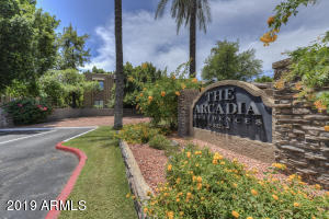 This turn-key condo is located in a quaint, gated community in an unbeatable location on the Camelback Corridor! Located on the ground floor, this unique corner unit boasts open concept layout offering plenty of space and natural light. Features include stacked indoor laundry, ample interior storage space, and a large covered patio with easy access to assigned parking. The gorgeous community grounds are adorned with lush plant life that exudes a park-like ambiance and amenities include a pool, spa, fitness center, clubhouse, and theater room!