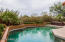 Refreshing pool with several water features. Pool fence is removable and not shown in this photo.