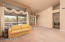 Spacious living room and dining room with neutral colored carpet and views.