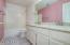Bathroom 2 with dual vanities and updated fixtures.
