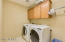 large laundry room upstairs