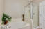 Very spacious master bathroom with separate tub and shower