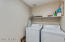 Large laundry room adjacent to kitchen