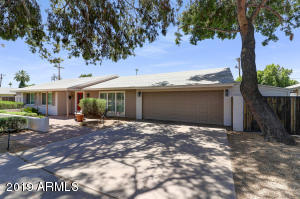 Rare rental in this fabulous Arcadia Lite neighborhood with views of Camelback from the front and rear. Remodeled ''great room'' floor plan with newer kitchen and baths. Wood floors, upgraded lighting and cabinets. Huge storage area in garage and another detached 10 X 20 storage shed in yard.Classic Farmer floorplan but upgraded nicely for an open feeling and large master bath. Rent includes pool and landscaping but not 2.3% sales tax to City of Phoenix. Application can be made at www.brokerypropmgmt.com.