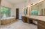 Master bath with granite countertops.