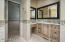 Vanity with cabinet outlets and custom built-ins