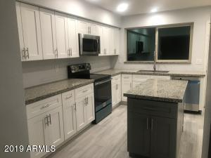 Brand new quality shaker cabinets, granite counters, new appliances