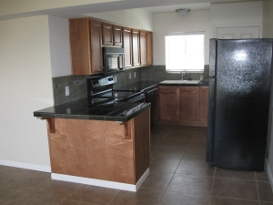 Fantastic remodeled kitchen with granite countertops, newer cabinets and appliances.