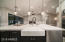 Kitchen View With Chic Lighting Fixtures