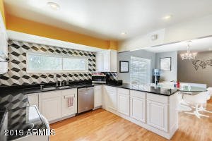 White cabinets, Black Granite and the hottest back splash!