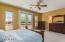 Double French doors to balcony with stairway down to BBQ Area/pool/spa