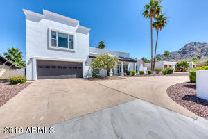 Views, Prime Location, Contemporary Design.. This gorgeous home has it all! Situated near the base of Piestewa Peak, with easy access to AZ-51, this beautifully updated home is located near plenty of local dining and shopping options. As you enter the bright, airy home, you are greeted by an open plan that flows between living, dining, and culinary space. The kitchen features custom cabinetry, granite counters, brick veneer back splashes, ample storage, a spacious window bar that connects to the patio, and a stunning, temperature-controlled wine wall. The split floor plan offers four bedrooms on the first level, and a spacious master suite, with separate office space, located on its own private, second floor retreat. Enjoy mountain views from the bedroom and a spa-like experience in the en-suite. The backyard is perfect for entertaining family and friends, and features a large, covered patio, Pebbletec pool, Sport Court, and grassy knoll. Scheduling your viewing today!