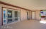 Covered backyard patio with french doors and kitchen entrance door