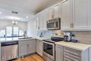Beautiful quartz counters, new cabinetry, subway tile backsplash, & stainless appliances ... all 2018!