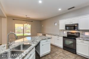 UPDATED w/tons of white cabinets, slate grey appliances, GORGEOUS high end granite counters & tiled backsplash!!!