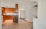 Spacious entry with gorgeous flooring greets you...