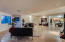 Expansive space with high ceilings, generous recessed can lighting, fireplace and VIEWS
