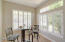 Breakfast area with great lighting just off the kitchen. Shutters throughout the home