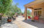 Largest lot features paver patio and landscaping with mature trees and artificial grass