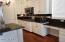 Remodeled white cabinets country French kitchen