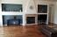 Freshly painted huge great room area acacia wood floors, fireplace and built in entertainment shelving unit