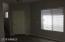 Photo in formal living room area viewing front door