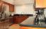 Kitchen including granite Slab Tops.
