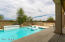 Newer Pool with Water Feature, Lounge Chairs and Sandy Beach Sitting Area