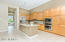 Kitchen with Slab Granite Counters and Stainless Appliances