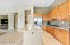 Kitchen with Built-in Refrigerator, Slab Granite, Kitchen Island & Gas Cooktop