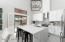 Kitchen features an oversized island with the continuous Carerra Quartz down the sides.
