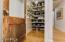 Walk-in pantry with antique door