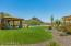 Huge Rear Yard with Synthetic Grass and Custom Desert Landscaping