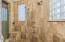 Stone Shower Stall with Windows and Additional Shower Fixtures