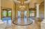 Entry feature Coffered Ceiling, Magnificent Chandelier, Iron Entry Door, Patterned Stone Flooring