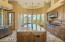 Kitchen receives large amounts of indirect light from the Wall of Windows