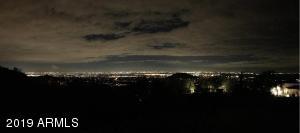 Watch the glistening city lights.
