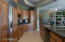Open Gourmet Kitchen with Upgraded Cabinetry and Slab Granite Counter Tops