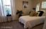 Secondary bedrooms with white shutters and new carpeting