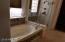 Spa style tub and upgraded bathroom features
