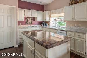 Spacious kitchen with granite, island, desk area