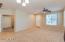 Den/bedroom opens to the Formal Living Space. Double doors.
