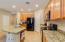 Beautiful Granite counter, Granite Island, Walk In Pantry, Tile Backsplash, Neutral Tile Flooring. Refrigerator Included!