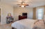 Spacious Master Bedroom with Direct Access to the Covered Patio. Neutral Carpet and Paint. Fans Throughout.