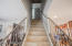 Staircase with beautiful tile and upgraded iron railing