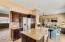 Kitchen opens to living/dining and family room
